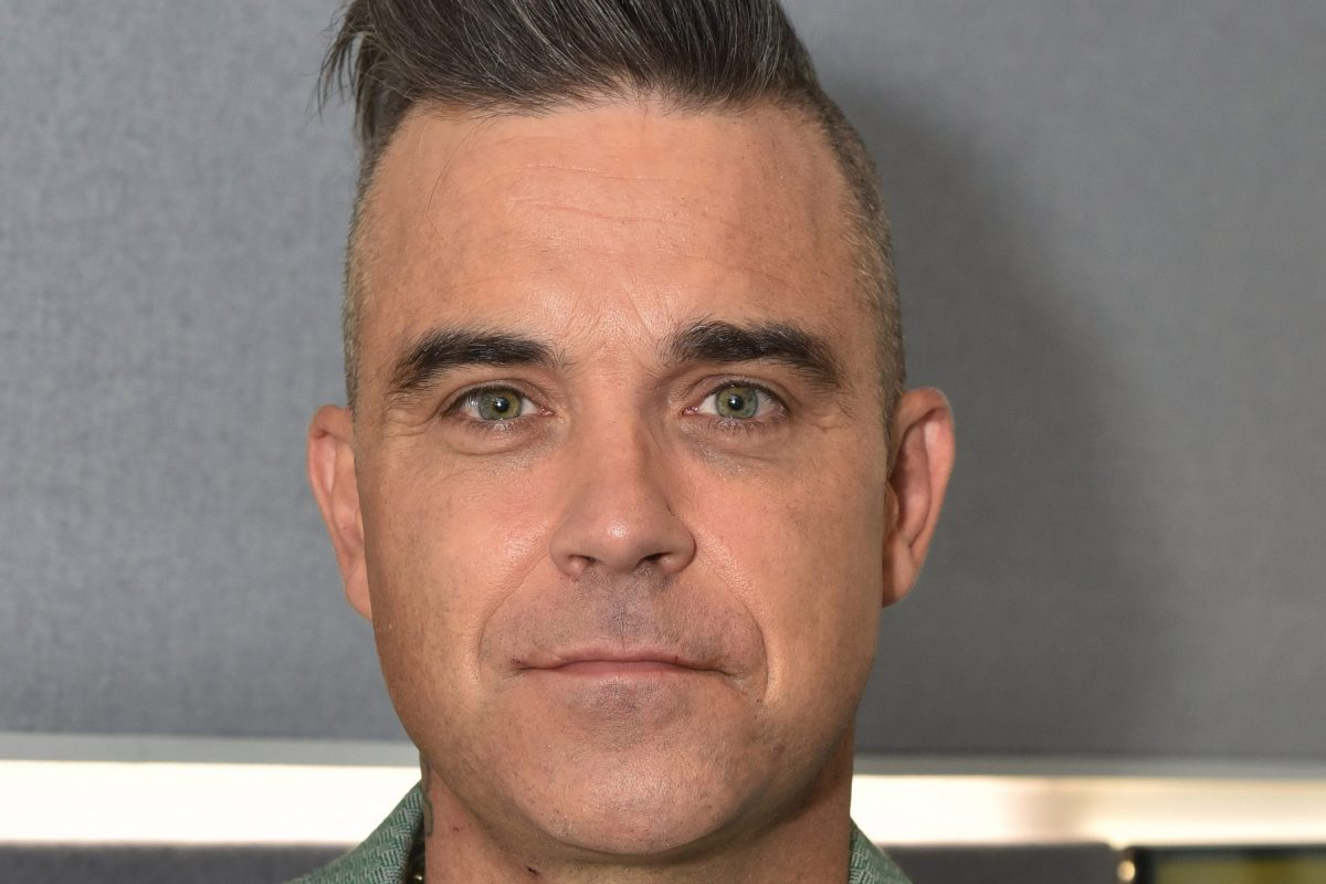 Robbie Williams mocks Coldplay's vow to be more eco friendly as he jokes about private jets