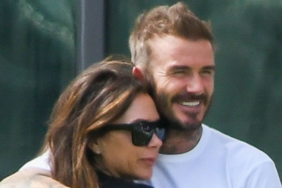 David Beckham kisses Victoria and son Brooklyn smooches girlfriend Nicola on family football stadium tour in Miami
