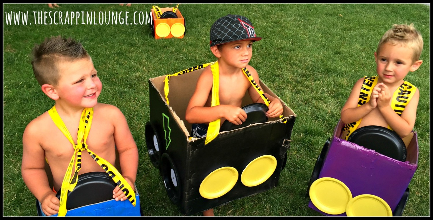 Three Boys in Monster Truck box cars