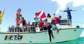 Kids celebrate after a dive during Kids Sea Camp with Divetech in Grand Cayman.