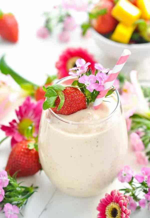 healthy smoothie recipes, Bright image of pink flowers fresh strawberries and a Healthy Strawberry Smoothie