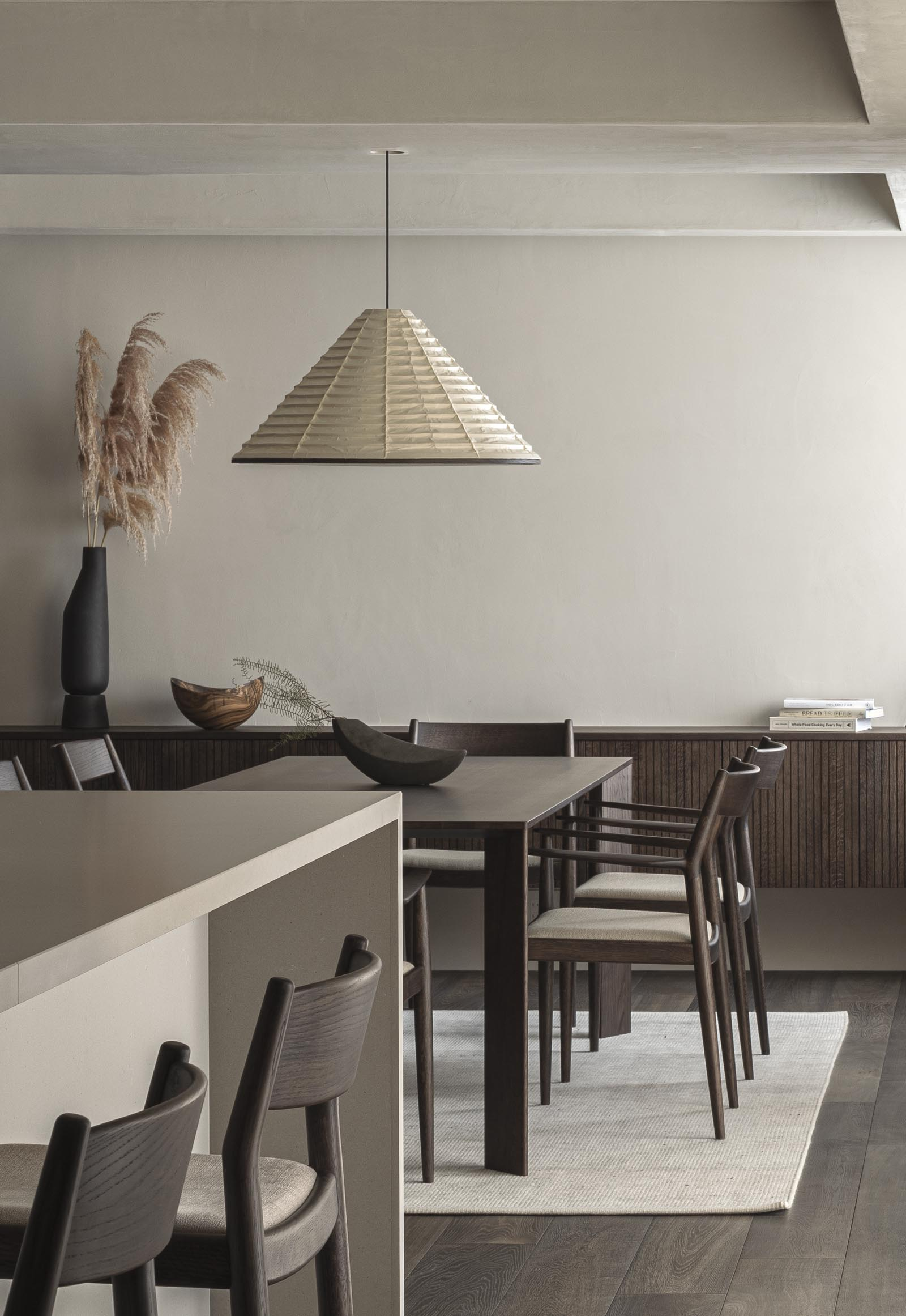Minimalist dining room in dark, earthy tones from Japandi design collaboration Karimoku Case Study | These Four Walls blog