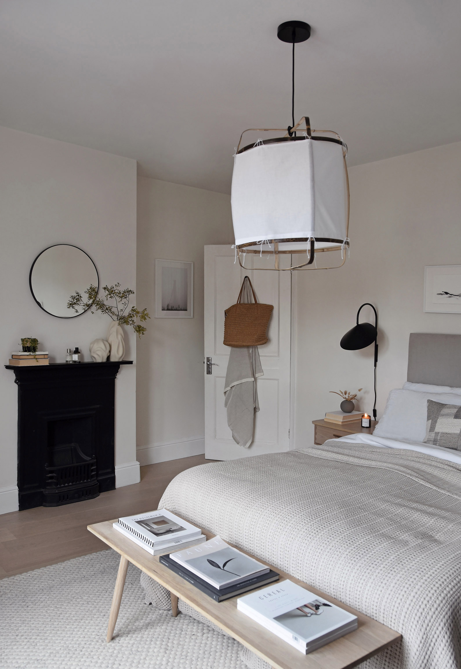 Minimalist beige bedroom with oak floor, statement lighting and soft, earthy tones   How to design a lighting scheme that works for you   These Four Walls blog