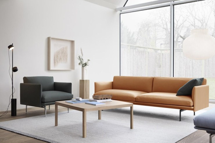 Minimalist white living room with grey armchair and tan leather sofa from Danish design brand Muuto | The design classics of the future | These Four Walls blog
