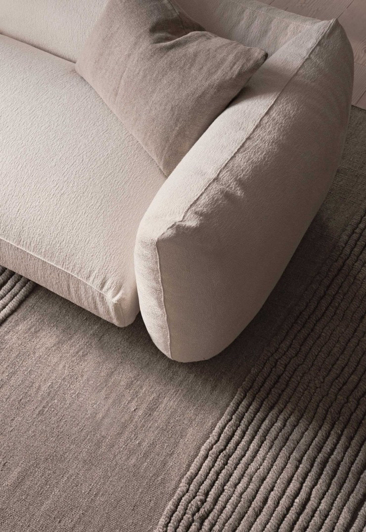 Curved beige bouclé sofa and tactile brown rug from Lotta Agaton's new collaboration with Scandinavian design brand Layered | New finds - July 2021 | These Four Walls blog