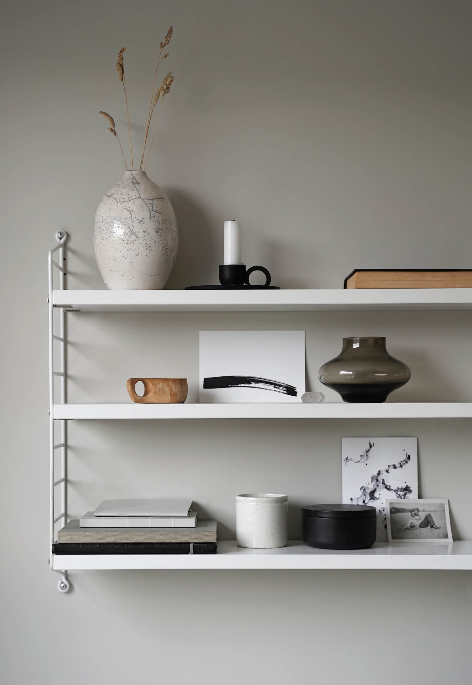 Minimalist shelf styling in a calming, neutral home office | These Four Walls blog