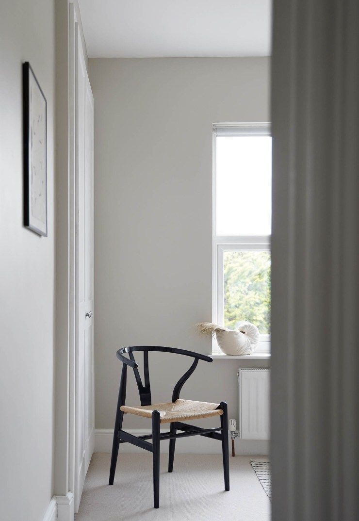 Minimalist home office decor with soft grey walls, pale beige carpet and blue CH24 Wishbone chair   These Four Walls blog