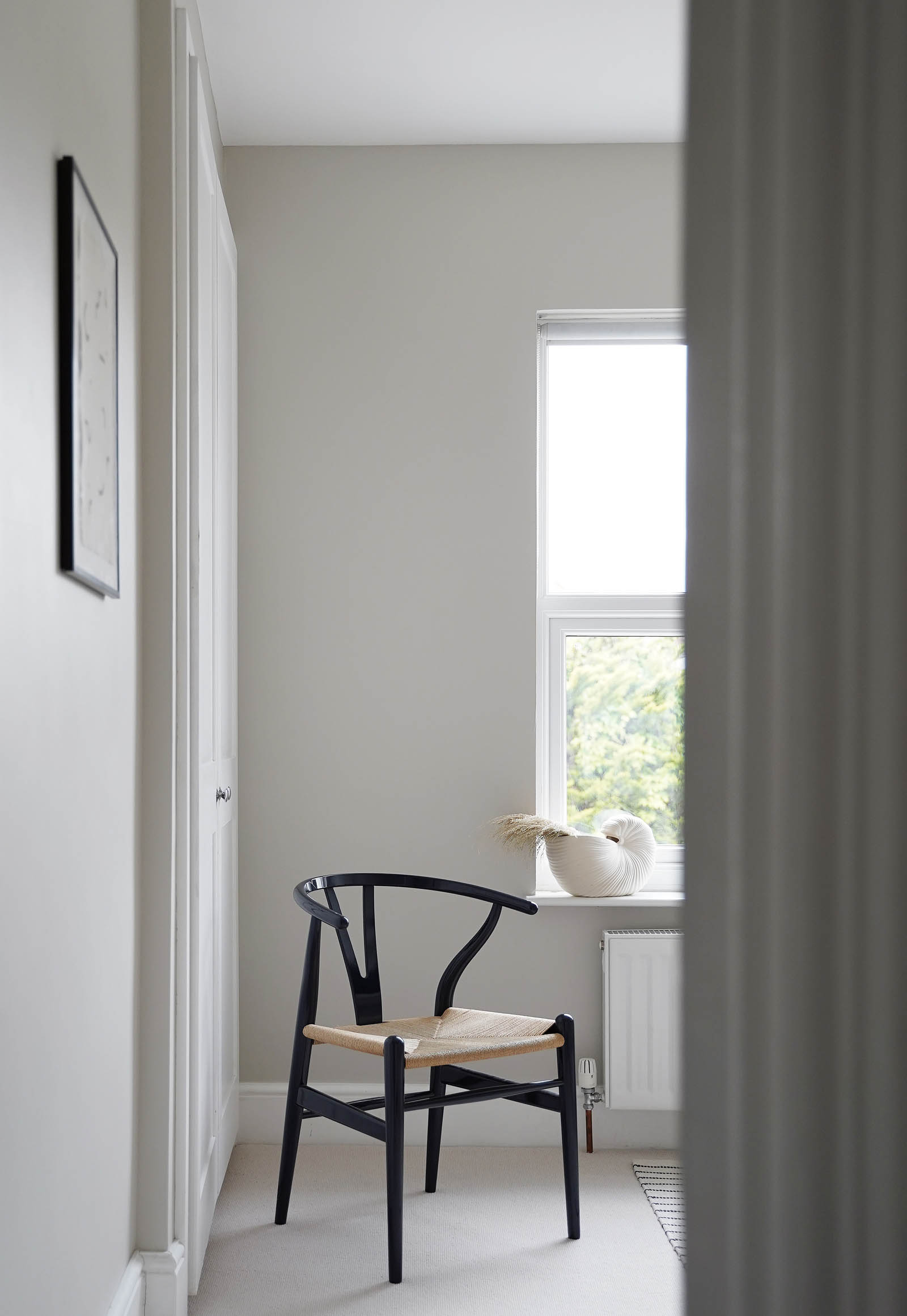 Minimalist home office decor with soft grey walls, pale beige carpet and blue CH24 Wishbone chair | These Four Walls blog