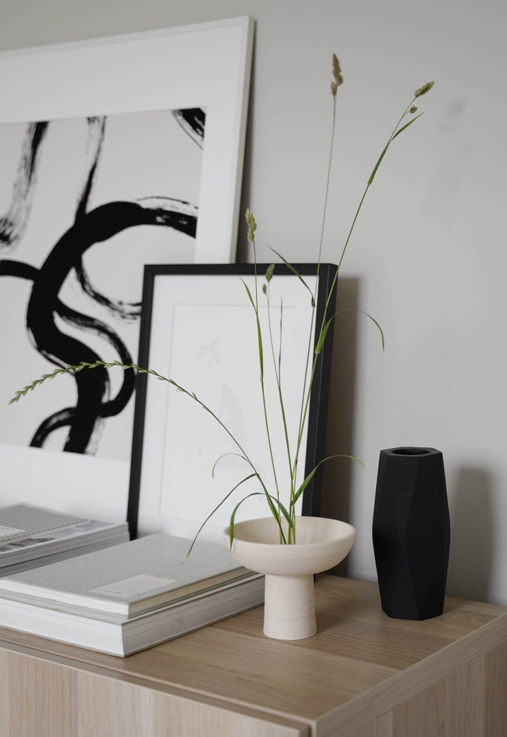 Japandi-style Ikebana arrangement with foraged grasses and minimalist black and beige ceramics   These Four Walls blog