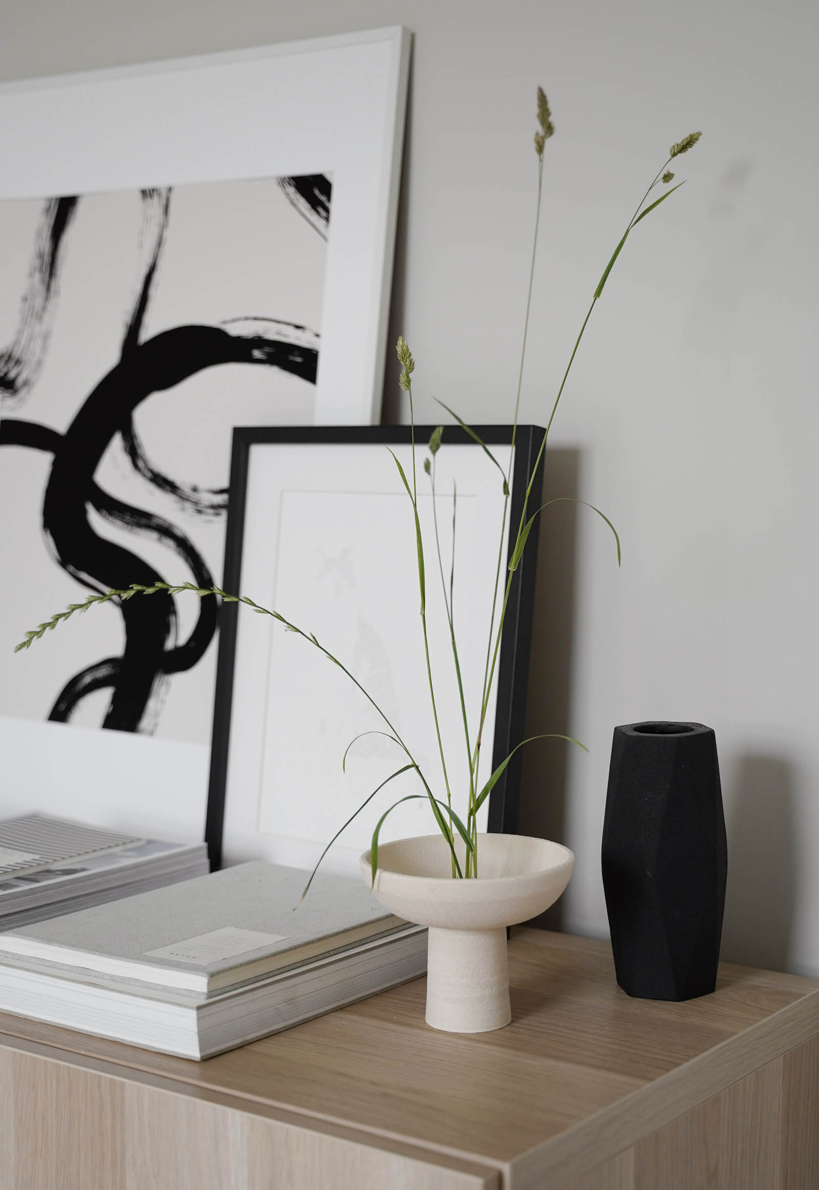 Japandi-style Ikebana arrangement with foraged grasses and minimalist black and beige ceramics | These Four Walls blog
