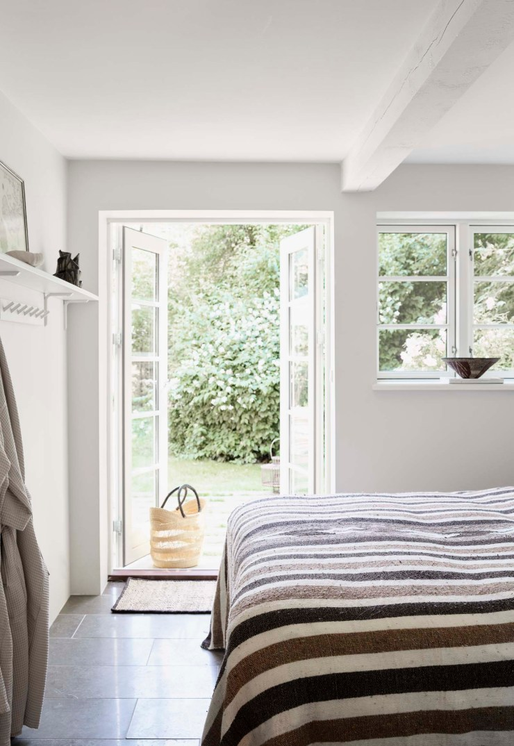 Rustic-minimalist white bedroom at the Vipp Farmhouse - a rural holiday cottage in Denmark   These Four Walls blog