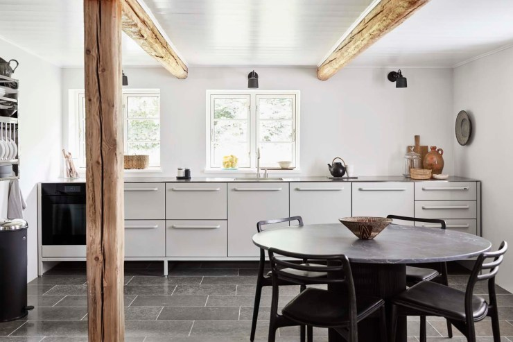 Contemporary minimalist kitchen in white, grey and black at the Vipp Farmhouse - a Scandinavian holiday cottage deep in the Danish countryside   These Four Walls blog