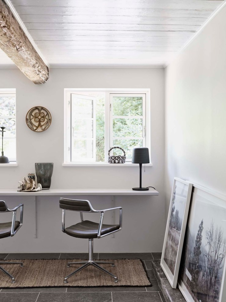 Rustic-minimalist home office with white walls and beamed ceiling at the Vipp Farmhouse - a Scandinavian holiday cottage deep in the Danish countryside   These Four Walls blog