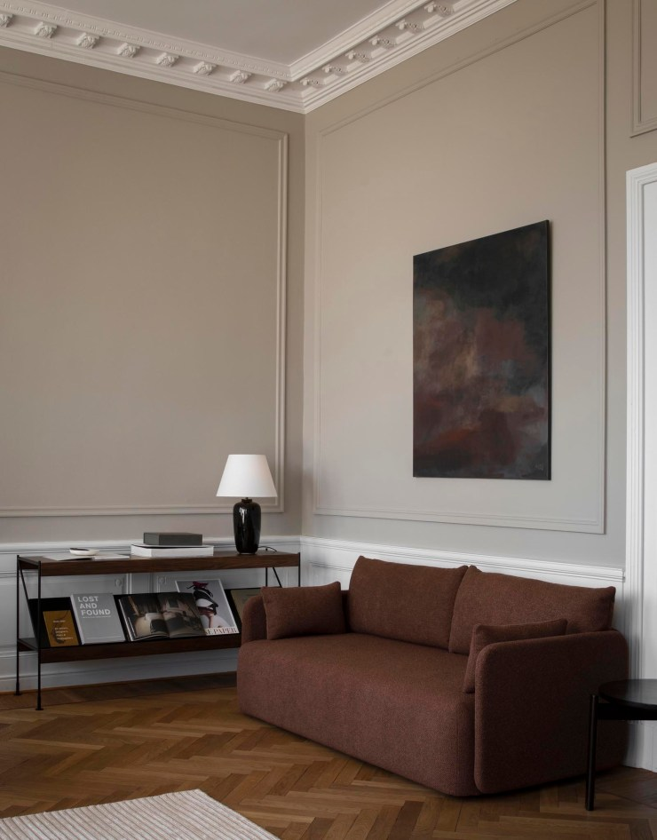 Beige living room with panelled walls, russet linen sofa, abstract art and minimalist modular storage system   The autumn-winter 2021 collection from Menu   These Four Walls blog