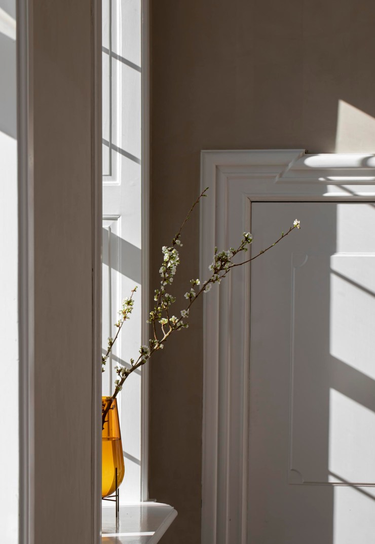 Period window with amber glass vase and blossoming branches   These Four Walls blog