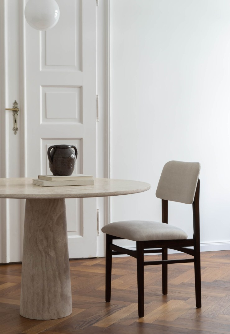 Minimalist dining room in an historic apartment, featuring circular marble table by Rebecca Goddard | These Four Walls blog
