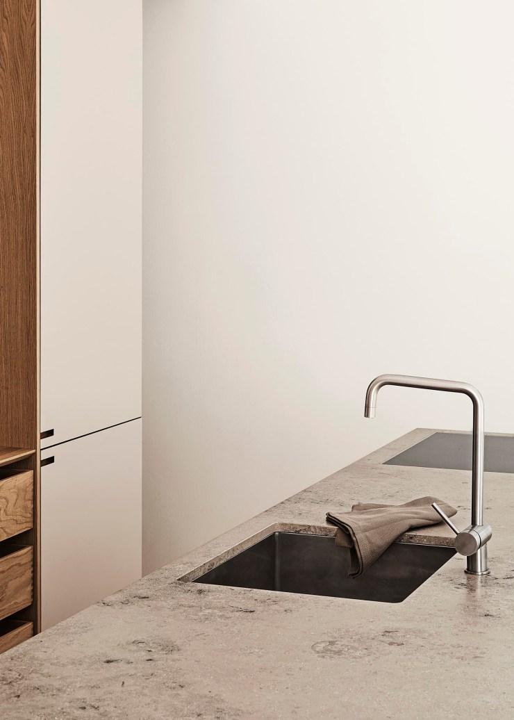 A warm, minimalist kitchen in beige, oak and Jura stone   These Four Walls blog