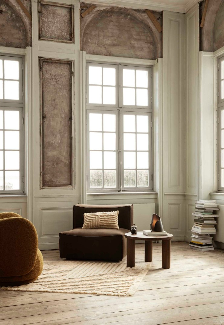 Period living room with panelled walls, minimalist brown armchair, beige rug, wooden side table and sculptural lamp | The autumn-winter 2021 collection from Ferm Living | These Four Walls blog