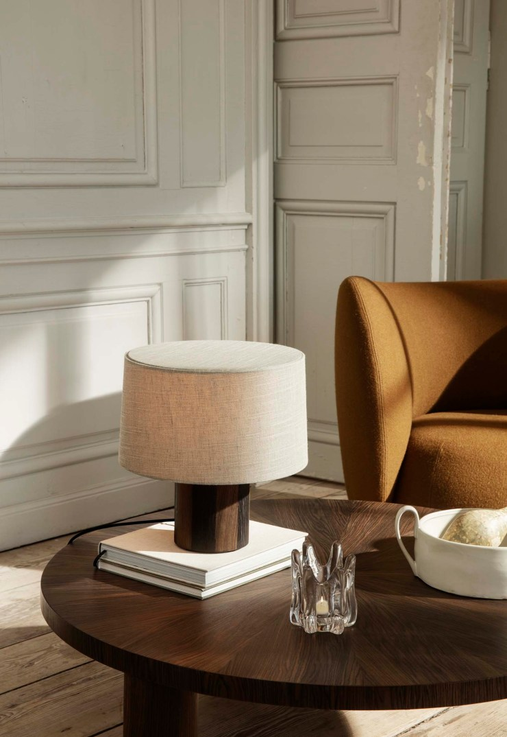 Minimalist table lamp, sculptural glass tea-light holder, curved armchair and neutral earthy tones from Ferm Living's autumn-winter 2021 collection | These Four Walls blog
