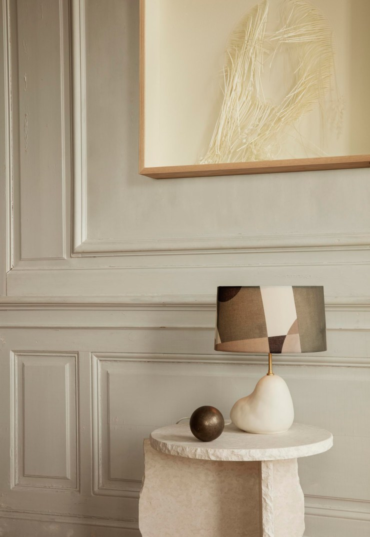 Beige panelled walls with sculptural marble table and contemporary lamp from Ferm Living's autumn-winter 2021 collection | These Four Walls blog