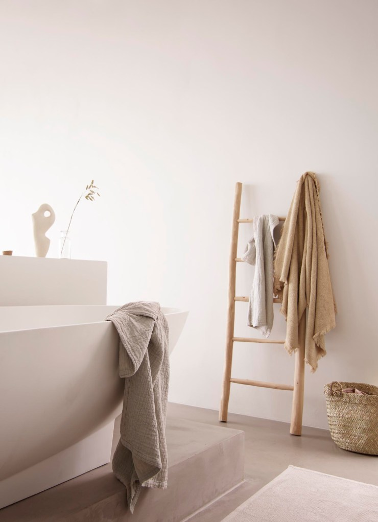 Contemporary minimalist bathroom with earthy neutral tones and natural materials from Tine K Home's latest collection | These Four Walls blog