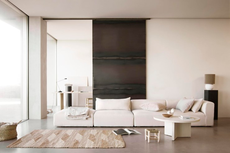 Relaxed living room with beige sofa, black sliding door and earthy neutral tones | Soft minimalism from Tine K Home's latest collection | These Four Walls blog