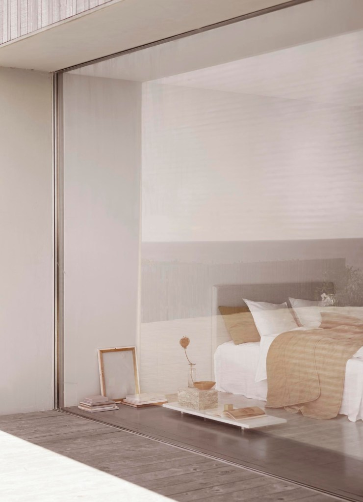 Minimalist bedroom in a contemporary timber-clad house, with autumnal colours and ochre bed linen from Tine K Home's latest collection | These Four Walls blog