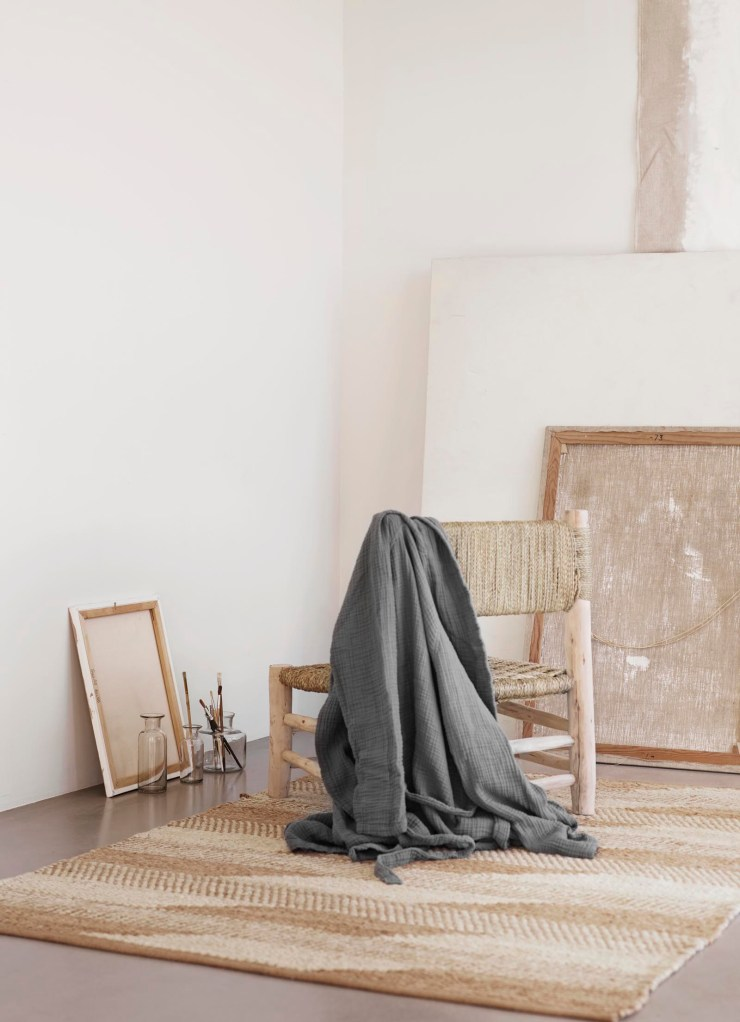 Rustic rattan chair with grey throw and jute rug | Soft minimalism from Tine K Home's latest collection | These Four Walls blog