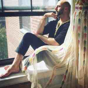 New York fashion designer Rami Kashou with one of his creations.