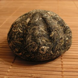 """""""Tea cakes"""" called Pu-erh are aged, and like wine—they can be aged for 100 years. (Photo by Jason Fasi)"""
