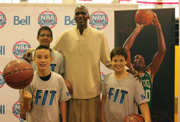 NBA legend Robert Parish poses with young Sun Youth athletes Jason Drivakos (from left), Trenton Dias-Maxwell and Luca Rienzo. (Photo: Joseph Munro)