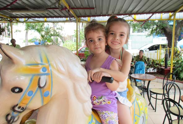 Sisters, Sara Ana and Sofia Laura, on a Sunday pony ride in Cuba