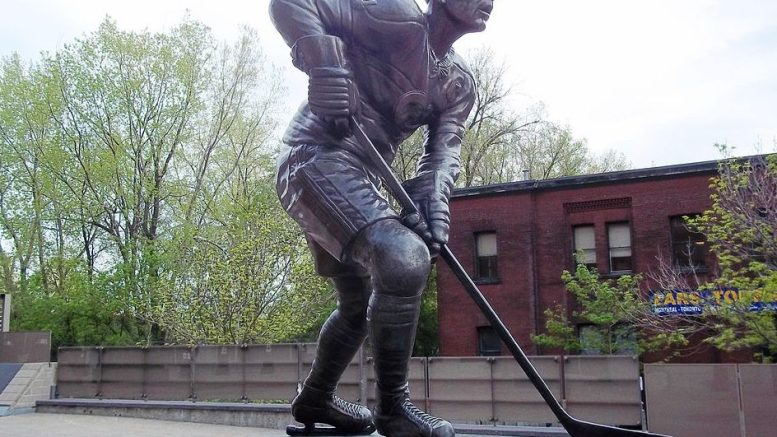 Jean Beliveau statue at the Bell Centre in Montreal. Photo by Jean Gagnon, cc Wikimedia Commons.