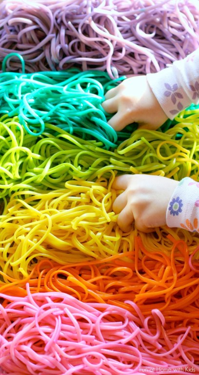 Rainbow Spaghetti Sensory Play. Click for more colorful St. Patrick's Day Sensory Bins