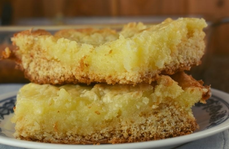 These decadent Yellow Cake Mix Gooey Bars are knock your socks off good and super easy to make with just six ingredients.