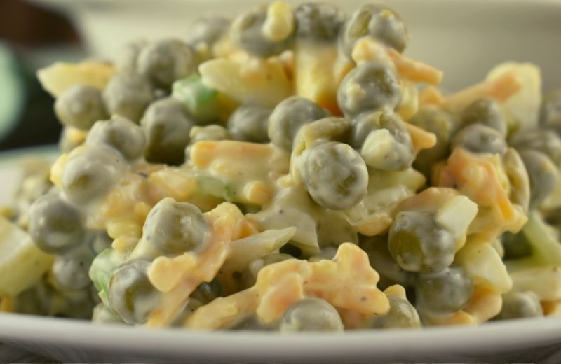 Using just one can of peas, this Old-Fashioned Pea Salad recipe is perfect for a side dish for a normal meal without too many leftovers. However, it can easily be doubled (or tripled) for cookouts and pitch-ins. This pea salad can be eaten right away or chilled for later.