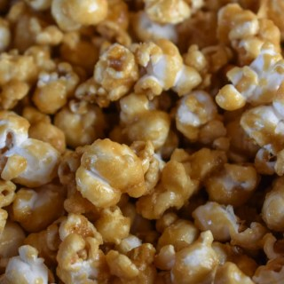 Grandma's Caramel Corn is a perfect homemade snack that will feed a crowd. The homemade, buttery caramel sauce makes this caramel corn recipe the best.