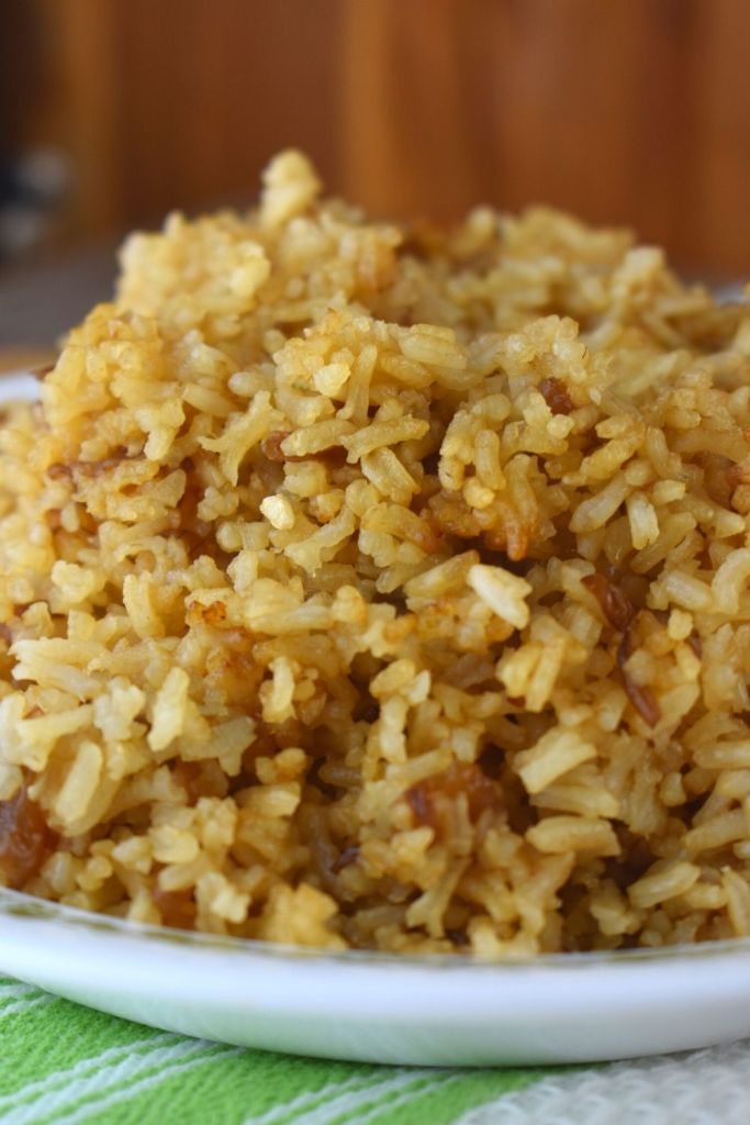 With only 4 ingredients, French Onion Rice Casserole has loads of rich flavor and is a great side dish for your favorite beef, chicken or pork dish. Often called Stick of Butter Rice, this French Onion Rice in Oven Recipe also uses condensed French Onion Soup, Beef Broth and Dry Instant Rice.
