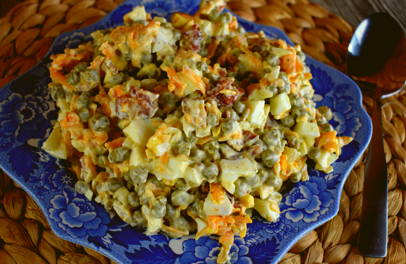 Easy Bacon Pea Salad is absolute perfection. The simple mixture of peas, bacon, shredded cheddar cheese, hard boiled eggs and mayonnaise marries together into the perfect summertime salad fit for any picnic or family get-together.