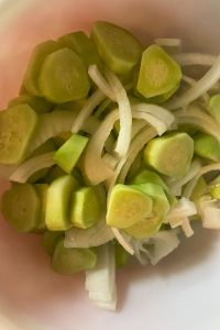 Mom's Cucumbers and Onions is an old fashioned recipe featuring garden vegetables. The ingredients are simple - cucumbers, onions, salt, vinegar, sugar, celery seed and black pepper, but the finished result is the perfect accompaniment to any summer meal.