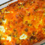 Loaded Breakfast Casserole has all the parts of your favorite breakfast wrapped into one decked out casserole---hash browns, eggs, cheese, sausage, bacon and ham. This recipe serves a crowd making it perfect for your next holiday brunch.