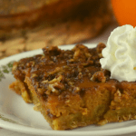 Praline Pumpkin Pie Bars are a three layer dessert that have all the elements of traditional pumpkin pie with an added brown sugar praline crunch on top. This recipe is straight from Grandma's wooden recipe box.