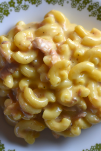 Tuna Macaroni and Cheese is a quick, stove top dinner that can be made from pantry staples. The extra cheesy tuna mac goodness will satisfy everyone in your house.