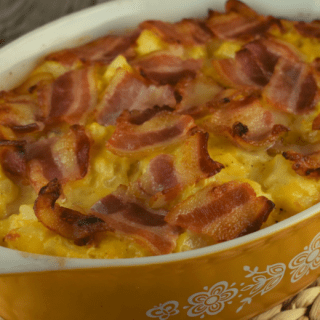Cheesy Potatoes with Bacon will be your new favorite side dish. It features an easy cheese sauce made with Velveeta, Miracle Whip, salt and black pepper and a bacon topping that sends the humble potato out of this world.