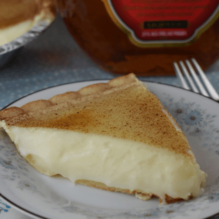 Amaretto Sugar Cream Pie takes two of my favorite things and makes the most incredible dessert----Amaretto and Sugar Cream Pie.  The filling is creamy and smooth and fantastically delicious.