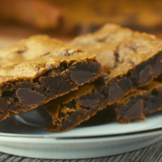 Chocolate Chip Molasses Bars are an old-fashioned molasses cookie with a dense texture.  They have that traditional molasses cookie flavor enhanced with the addition of chocolate chips.  Making these as a bar cookie cuts down time and energy.