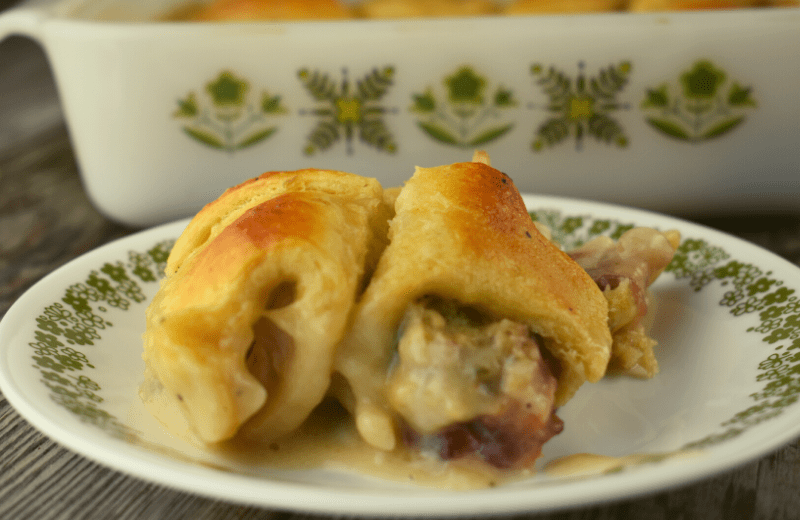 Leftover Thanksgiving Crescent Casserole takes all your favorite holiday leftovers and creates a brand new delicious meal.  Use up that leftover turkey, cranberry sauce and dressing by stuffing it in a canned crescent roll and baking in a yummy sauce of leftover gravy and milk.