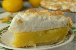 Grandma's Lemon Meringue Pie is a simple, old fashioned recipe that features fresh lemon juice.  This recipe is a lemon pie without cornstarch instead using regular flour as a thickener.  It's the perfect balance between sweet and tart, and the rustic appearance makes it a favorite among amateur bakers.