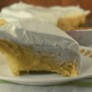 Old Fashioned Peanut Butter Pie is a from scratch pudding pie that has a decadent peanut butter flavor and smooth, creamy texture. You may never buy a boxed pudding mix again after making this easy pudding filling.