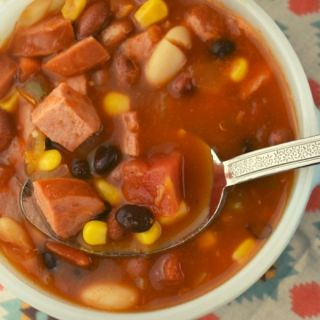 Southwestern Three Bean Soup is a hearty soup with simple ingredients.  The southwest flavors complement a combination of chili beans, black beans and white kidney beans.  Make a huge pot of this and eat on it for the whole week.